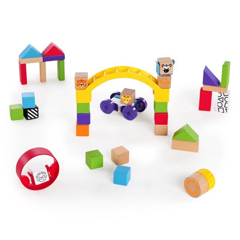 BABY EINSTEIN Hračka drevená stavebnica Curious Creations Kit HAPE 12m+